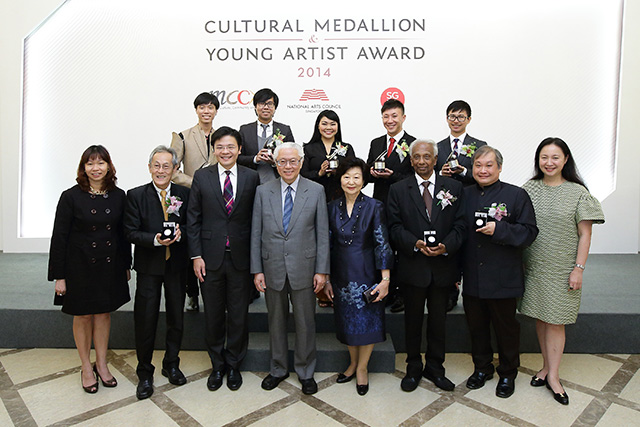 14 (L-R) NAC CEO Ms Kathy Lai, Minister, President, First Lady and MCCY Permanent Secretary Ms Yeoh Chee Yan with the eight CM and YAA recipients