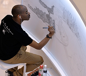 World renowned British artist and autistic savant Stephen Wiltshire drew the Singapore cityscape  from memory in July 2014.  Photo courtesy of Singapore Press Holdings.