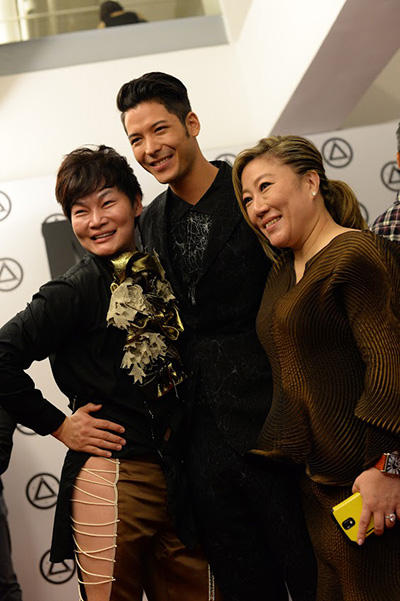 Celebrity model Henrique Fukoaka flanked by MAD Founder Ms Jasmine Tay and a guest