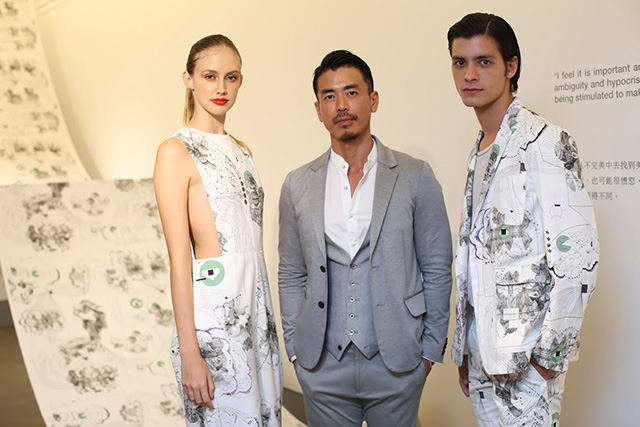 Japanese artist Yuji  Mizuta with models wearing his artwork in clothes made by Zin Catell