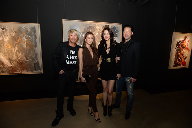 Kim Robinson, Jennifer Tse, Janet Ma, and Michael Wong posing against Kim's artwork series, Evocateur