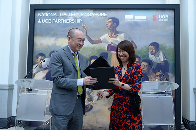 Mr Wee Ee Cheong and Ms Chong Siak Ching exchanging the contract