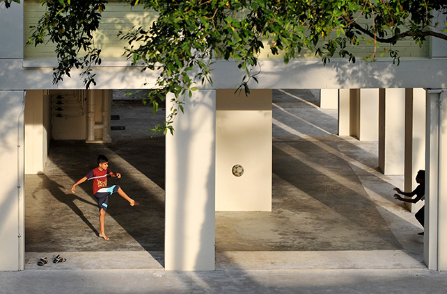 Two boys kicking a soccer ball at the void deck of a block of housing apartments in Bishan in July 2012. ST Photo: Alphonsus Chern