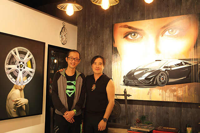 Art Xchange Gallery Director Benny Oentoro posing with Jerry Cheong