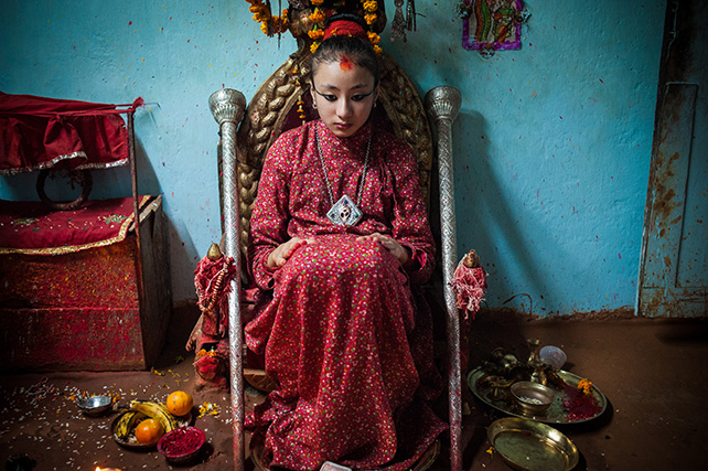 Living with Goddesses, Catherine Sim (Singapore).  The Kumari is believed to be an incarnation of Taleju, the divine universal-mother goddess. Every few years, a Nepalese girl aged 4-5 years old is chosen from thousands using Hindu elaborate rituals. The new elect takes over the lonely throne, which the old Kumari abdicates upon reaching puberty.