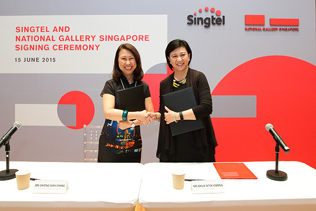 Ms Chong Siak Ching, National Gallery Singapore CEO (left) and Ms Chua Sock Koong, Singtel Group CEO (right) at the signing ceremony