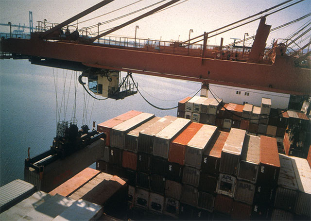Allan Sekula, Hammerhead crane unloading forty-foot containers from Asian ports. American President Lines terminal. Los Angeles harbour. San Pedro, California, Fish Story, Chapter 1: Fish Story (1992). Frac Bretagne Collection, France © The Estate of Allan Sekula.