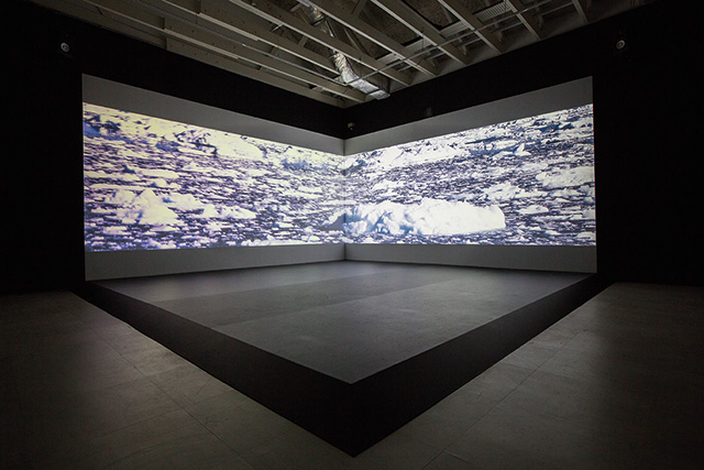 Ong Kian Peng, Too Far, Too Near, 2015 DC Motor, Metal balls, Steel structure; 2-channel video with 3-channel sound Dimensions variable, Duration: 15 mins, Singapore Art Museum commission, Collection of the Artist Image credit: Singapore Art Museum