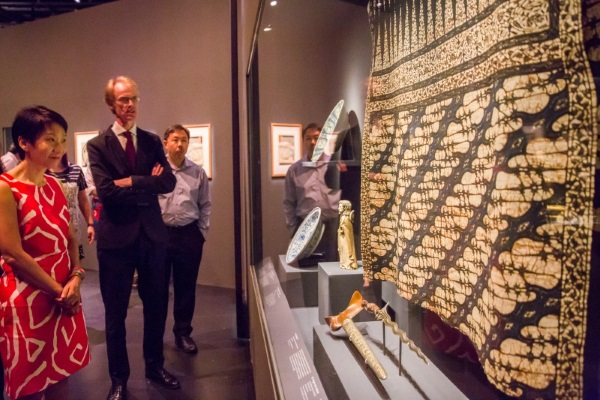 In this picture, British Museum Curator Brendan Moore highlights one of the earliest recorded batik cloths that is part of the British Museum's Sir Stamford Raffles collection.