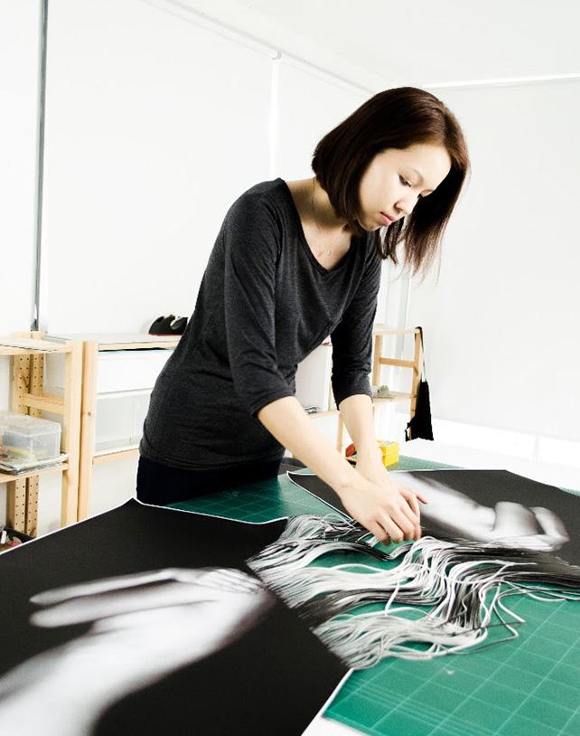 Kamolpan Chotvichai at work in her Bangkok studio